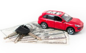 toy car on cash and car key