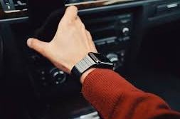 holding steering wheel